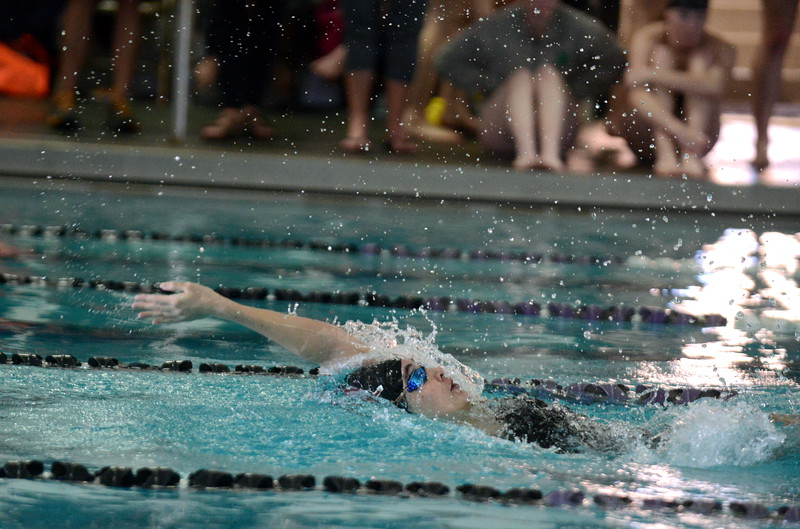 Berthoud's Jamie Dellwardt breaks away from the pack to win the 100-yard backstroke at Saturday's Mountain View Invitational at the Mountain View Aquatic Center. (Mike Brohard/Loveland Reporter-Herald)
