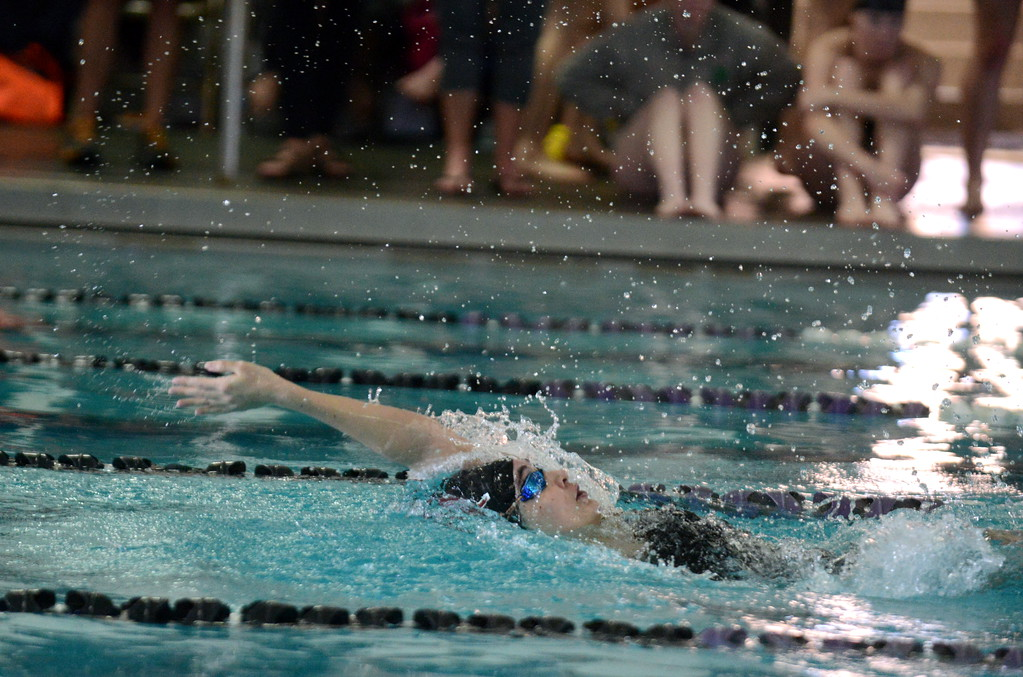 . Berthoud\'s Jamie Dellwardt breaks away from the pack to win the 100-yard backstroke at Saturday\'s Mountain View Invitational at the Mountain View Aquatic Center. (Mike Brohard/Loveland Reporter-Herald)