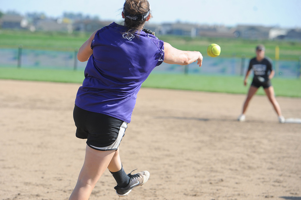 . Mountain View senior RaLeigh Basart throws to first during a practice Friday, August 10, 2018 at Mountain View High School in Loveland, Colorado. (Sean Star/Loveland Reporter-Herald)