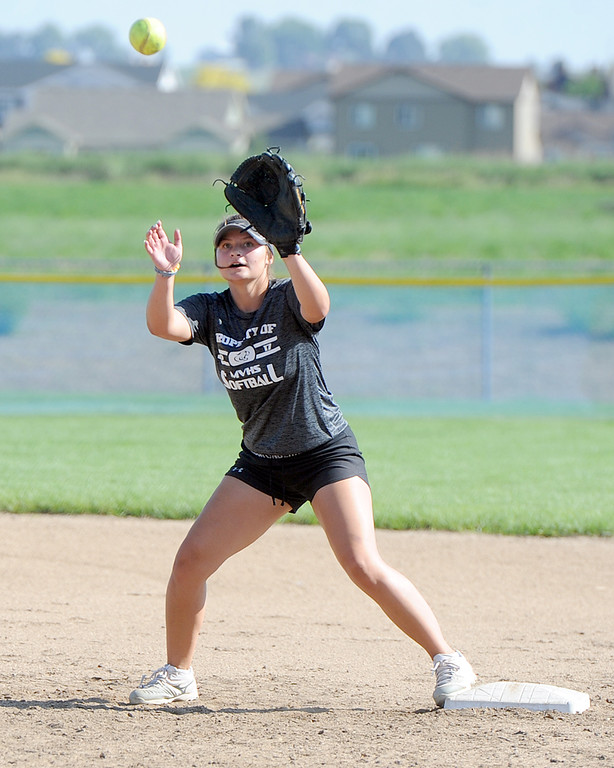 . Mountain View junior Morgan Jewell makes a catch during a practice Friday, August 10, 2018 at Mountain View High School in Loveland, Colorado. (Sean Star/Loveland Reporter-Herald)