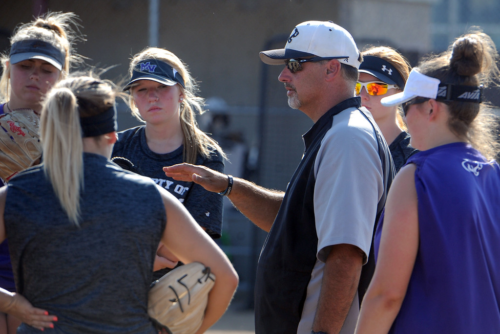 . Mountain View softball coach Randy Felton, middle, talks with his team during a practice Friday, August 10, 2018 at Mountain View High School in Loveland, Colorado. (Sean Star/Loveland Reporter-Herald)