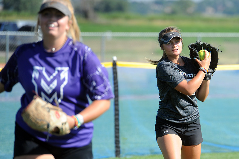 Mountain View junior Morgan Jewell, right, makes a catch behind teammate Bailey Carlson during a practice Friday, August 10, 2018 at Mountain View High School in Loveland, Colorado. (Sean Star/Loveland Reporter-Herald)