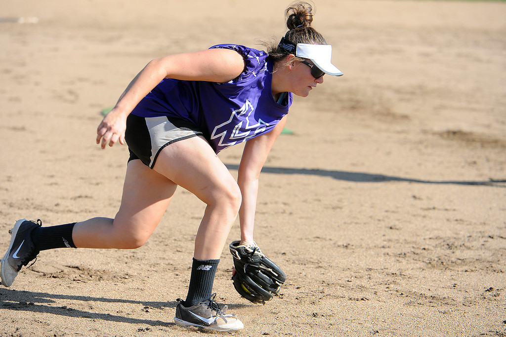 . Mountain View senior RaLeigh Basart scoops up a grounder during a practice Friday, August 10, 2018 at Mountain View High School in Loveland, Colorado. (Sean Star/Loveland Reporter-Herald)