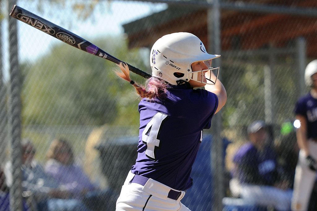 . Mountain View\'s Lilly Reed takes a swing during the 4A Region 6 tournament on Saturday, Oct. 13, 2018 at Barnes Complex in Loveland. (Sean Star/Loveland Reporter-Herald)