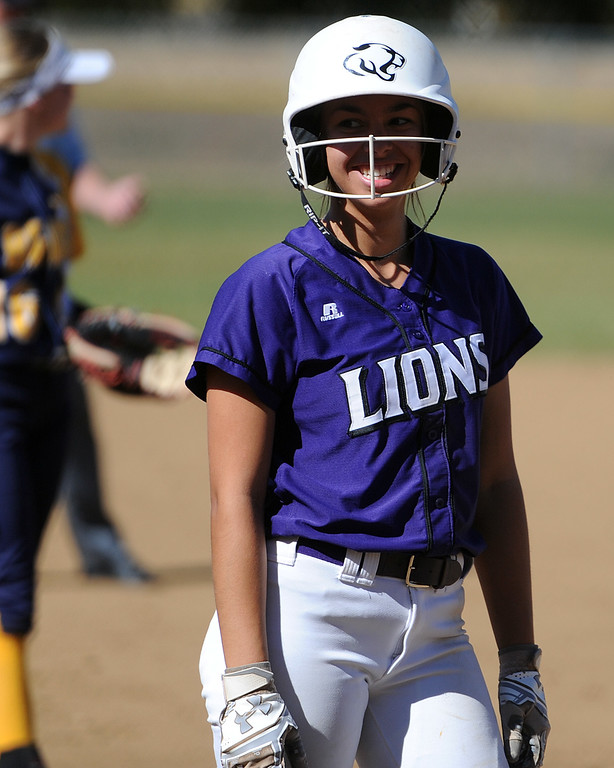 . Mountain View\'s Nya Chacon smiles toward the dugout during the 4A Region 6 tournament on Saturday, Oct. 13, 2018 at Barnes Complex in Loveland. (Sean Star/Loveland Reporter-Herald)