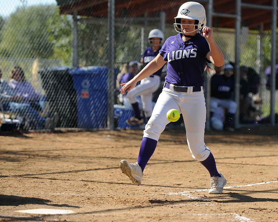. Mountain View\'s Lilly Reed avoids an errant throw to the plate as she scores a run during the 4A Region 6 tournament on Saturday, Oct. 13, 2018 at Barnes Complex in Loveland. (Sean Star/Loveland Reporter-Herald)
