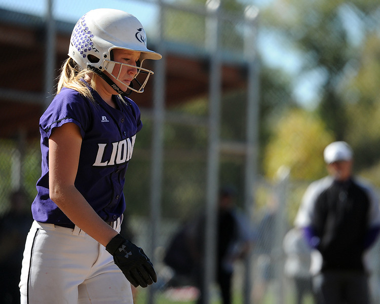 Mountain View's Harley Duke winces after getting hit by a pitch during the 4A Region 6 tournament on Saturday, Oct. 13, 2018 at Barnes Complex in Loveland. (Sean Star/Loveland Reporter-Herald)