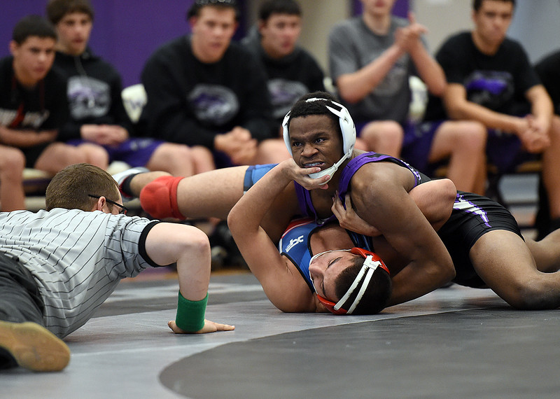 Mountain View's Semaj Spencer wrestles Centaurus'  during their 170 pound match at Mountain View High School in Loveland. (Photo by Jenny Sparks/Loveland Reporter-Herald)