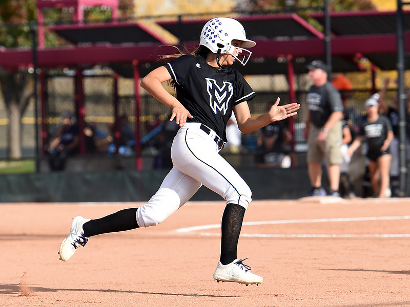 Mountain View's (7) Nya chacon rounds the bases during their game against Discovery Canyon Friday, Oct. 20, 2017, during State Softball at the Aurora Sports Park in Aurora. (Photo by Jenny Sparks/Loveland Reporter-Herald)