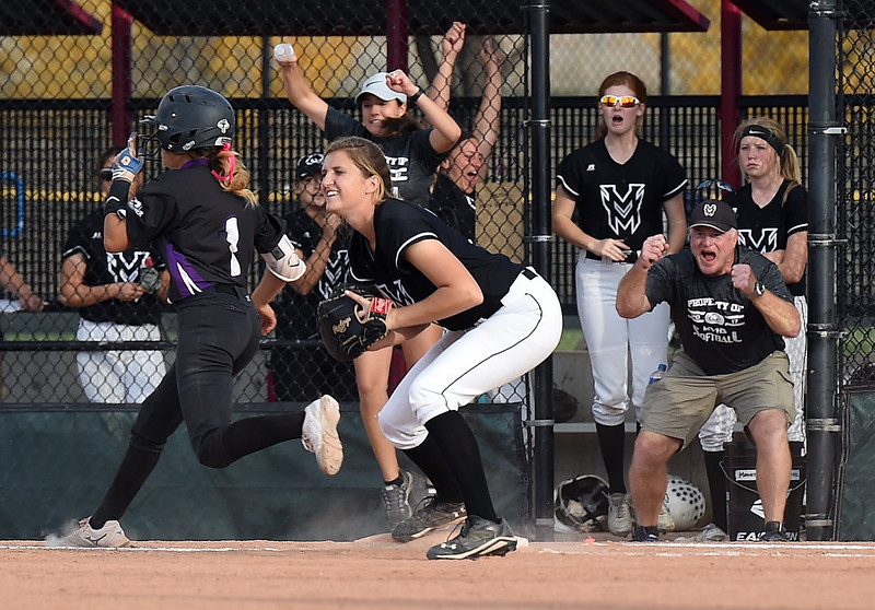 Mountain View's (12) Madi Langman tags out Discovery Canyon's (1) Aber Rees for the win Friday, Oct. 20, 2017, during State Softball at the Aurora Sports Park in Aurora. (Photo by Jenny Sparks/Loveland Reporter-Herald)
