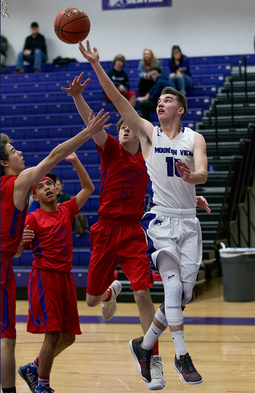 . Mountain View\'s Shane Shadowen (10) shoots against the Centaurus defense Thursday evening Feb., 8, 2018 at Mountain View High School in Loveland. The Mountain Lions lost to the visiting Warriors, 48-44. (Michael Brian/For the Reporter-Herald)