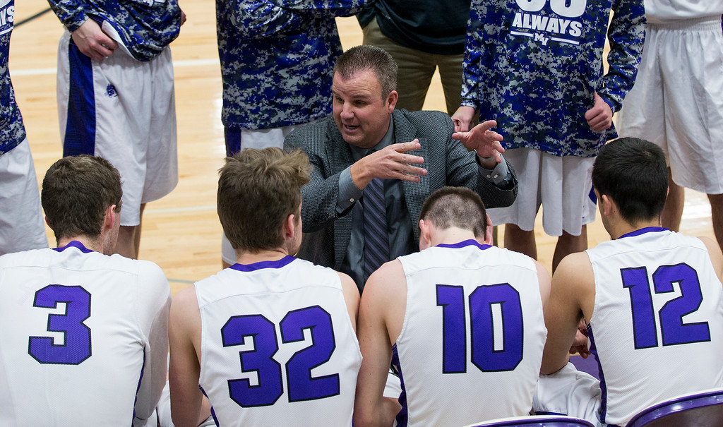. Mountain View head coach Mike Jobman talks to his team during a second-half timeout against Centaurus Thursday evening Feb., 8, 2018 at Mountain View High School in Loveland. The Mountain Lions lost to the visiting Warriors, 48-44. (Michael Brian/For the Reporter-Herald)