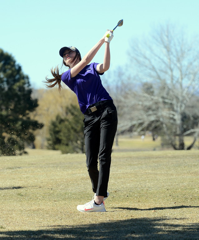 . Genna Stobbe of Mountain View watches her drive during Tuesday\'s round at the Mountain View league meet played at the Olde Course. (Mike Brohard/Loveland Reporter-Herald)