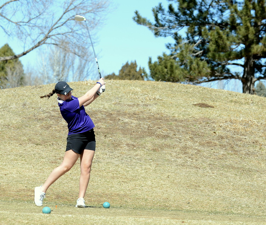 . Mountain View senior Katie Haag hits a tee shot during Wednesday\'s Mountain View league meet at the Olde Course in Loveland. Haag was able to play 18 holes without pain, an encouraging sign since being sideline since midway through her sophomore season. (Mike Brohard/Loveland Reporter-Herald)
