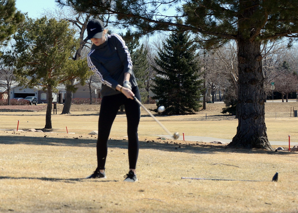 . Thompson Valley\'s Lauren Snodgrass finds out of of trouble and back onto the fairway during Tuesday\'s round at the Mountain View league meet played at the Olde Course. (Mike Brohard/Loveland Reporter-Herald)