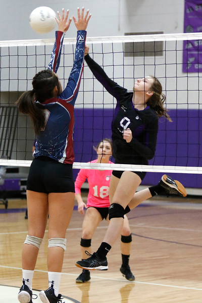 Mountain View's Madi Emsing (9) spikes the ball back at Northridge's Abby Herold (7) on Tuesday, Sept. 26, 2017 at Mountain View High. (Lauren Cordova/Loveland Reporter-Herald)