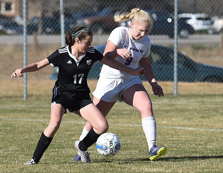 Mountain View's #9 Ashley McCall  and Berthoud's #17 RaeAnn Fooks battle for the ball Wednesday, March 29, 2017, during their game at Mountain View High School in Loveland. (Photo by Jenny Sparks/Loveland Reporter-Herald)