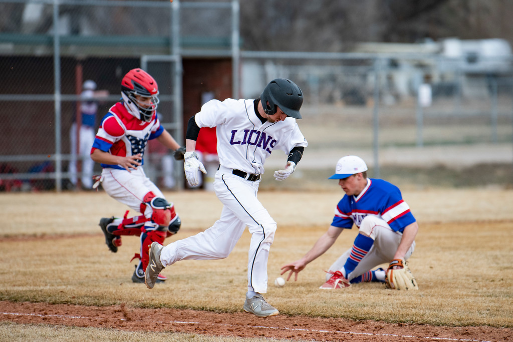 . Mountain View\'s Jaron Davis sprints down the first base line as Centaurus infielders work to make a play during a game at Greg Brock Field on Friday, March 22, 2019. The Lions defeated Centaurus 4-3.