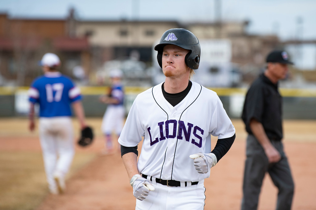 . Mountain View\'s Dylan Naughton jobs in to the dugout after he is called out during a game against Centaurus at Greg Brock Field on Friday, March 22, 2019. The Lions defeated Centaurus 4-3.