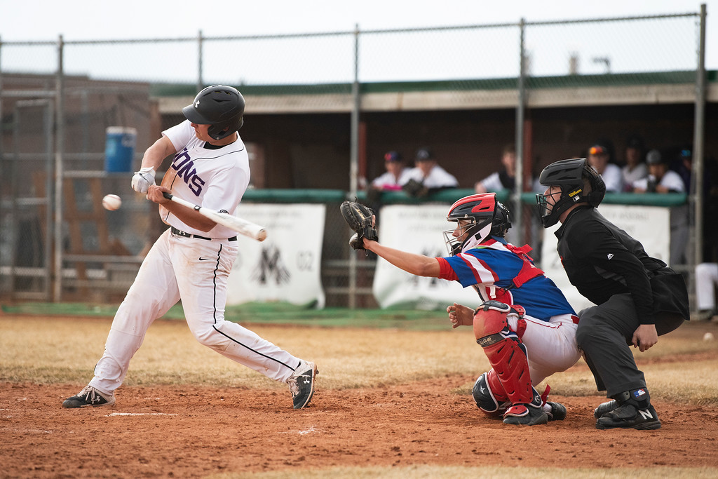 . Mountain View\'s Toby Armstrong swings and misses as he is struck out in a game against Centaurus at Greg Brock Field on Friday, March 22, 2019. The Lions defeated Centaurus 4-3.