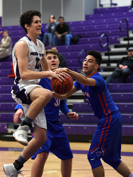 Mountain View's #31 Brian Flohr tries to get past Centaurus' #31 John Houlihan and #1 Grayson Walker for a shot during their game Tuesday, Jan. 17, 2017, at Mountain View High School in Loveland. (Photo by Jenny Sparks/Loveland Reporter-Herald)<br /> mv31 c 31 left 1 right