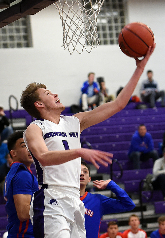 Mountain View's #1 Trey Bruschke goes up for a shot during their game against Centaurus Tuesday, Jan. 17, 2017, at Mountain View High School in Loveland. (Photo by Jenny Sparks/Loveland Reporter-Herald)