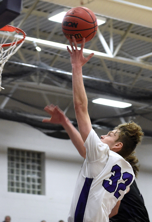 . Mountain View\'s Trey Bruschke goes up for a shot during their game against Discovery Canyon Wednesday, Feb. 20, 2019, at Mountain View High School in Loveland.   (Photo by Jenny Sparks/Loveland Reporter-Herald)