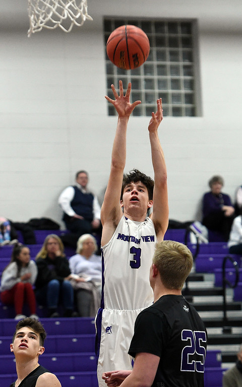 . Mountain View\'s Alex Hurr shoots a three pointer duirng their game against Discovery Canyon on Wednesday, Feb. 20, 2019, at Mountain View High School in Loveland.   (Photo by Jenny Sparks/Loveland Reporter-Herald)