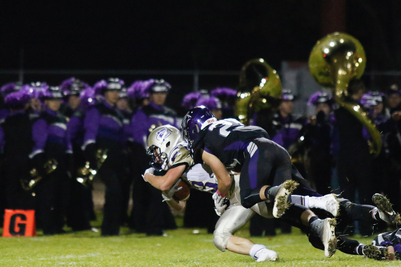 Mountain View's Jackson Gilbert (21) tackles Fort Collins' Michael Remmers (3) just before the goal line on Friday, Oct. 13, 2017, at Patterson stadium in Loveland. (Photo by Lauren Cordova/Loveland Reporter-Herald)