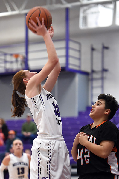 Mountain View's #33 Gabby Valland goes up for a shot during their game against Greeley Central Wednesday, Feb. 15, 2017, at Mountain View in Loveland.  (Photo by Jenny Sparks/Loveland Reporter-Herald)