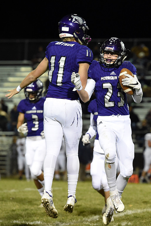 . Mountain View\'s Cade Bender celebrates his interception with Lukas Arthur during their game against Greeley West on Thursday, Nov. 1, 2018, at Patterson Stadium in Loveland.  (Photo by Jenny Sparks/Loveland Reporter-Herald)