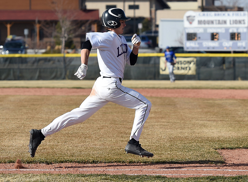 Mountain View's (5) Tanner Cartmell runs to first base Wednesday, March 21, 2018, during their game against Longmont at Mountain View in Loveland.  (Photo by Jenny Sparks/Loveland Reporter-Herald)