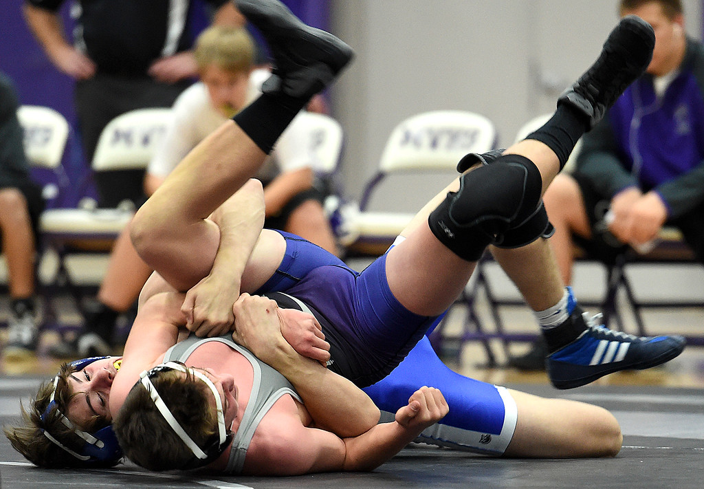 . Longmont\'s Andrew Wilson wrestles Mountain View\'s Riley Cogan during their 145-pound match Thursday, Dec. 14, 2017, at Mountain View High School in Loveland. Wilson won the match.  (Photo by Jenny Sparks/Loveland Reporter-Herald)