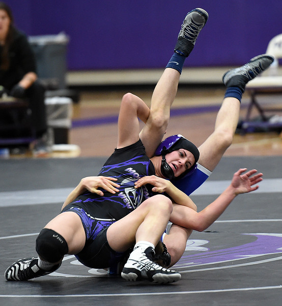 Mountain View's Kaley Barker wrestles Longmont's Gabe Sedillos during their 113-pound match Thursday, Dec. 14, 2017, at Mountain View High School in Loveland. Barker won the match.  (Photo by Jenny Sparks/Loveland Reporter-Herald)113