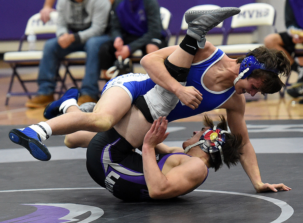 . Longmont\'s Brayden Engelking takes down Mountain View\'s Jackson Gilbert during their 160-pound match Thursday, Dec. 14, 2017, at Mountain View High School in Loveland. Gilbert won the match.  (Photo by Jenny Sparks/Loveland Reporter-Herald)