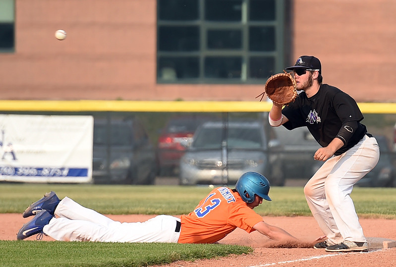 Mountain View's (8) Colter Williams catches the ball as Longmont/Erie's (13) tries to get back to first base Tuesday, June 27, 2017, during their game at Brock Field in Loveland. (Photo by Jenny Sparks/Loveland Reporter-Herald)
