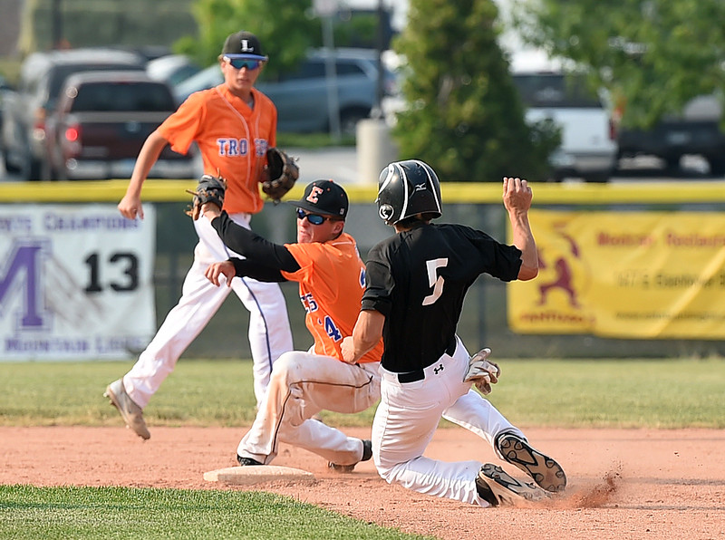 Mountain View's (5) Nate Vondy slides into second base as Longmont/Erie's (24) catches the ball Tuesday, June 27, 2017, during their game at Brock Field in Loveland. (Photo by Jenny Sparks/Loveland Reporter-Herald)
