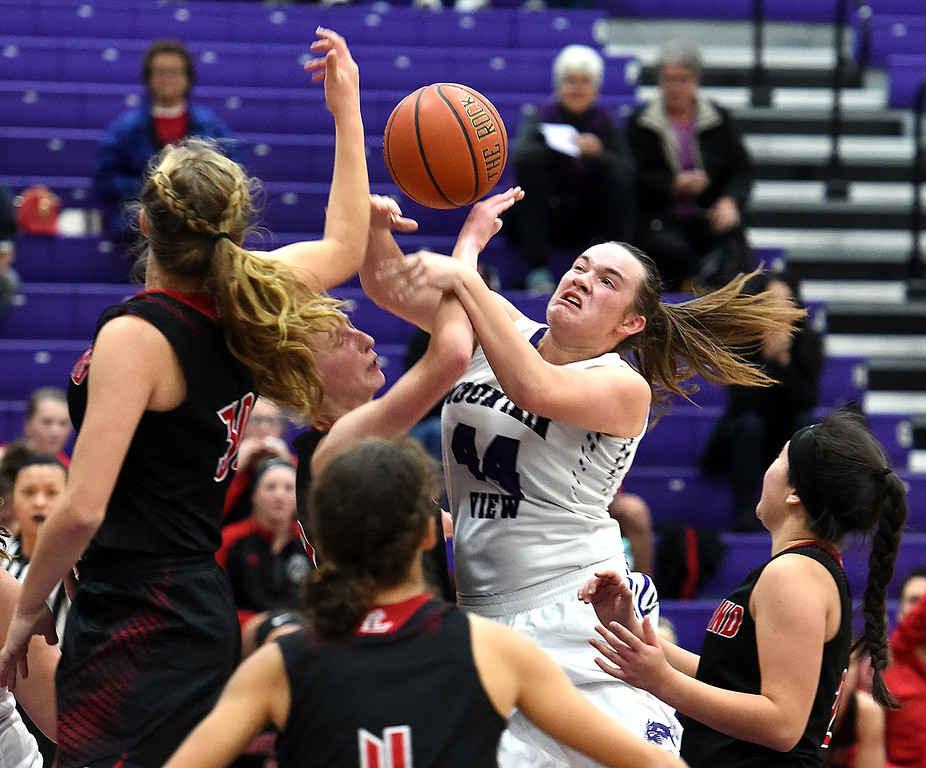 . Mountain View\'s RaLeigh Basart goes up for a shot during their game against Loveland on Wednesday, Nov. 28, 2018, at Mountain View High in Loveland. (Photo by Jenny Sparks/Loveland Reporter-Herald)