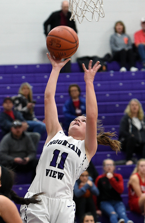 . Mountain View\'s Kelsey Basart goes up for a shot during their game against Loveland on Wednesday, Nov. 28, 2018, at Mountain View High in Loveland. (Photo by Jenny Sparks/Loveland Reporter-Herald)