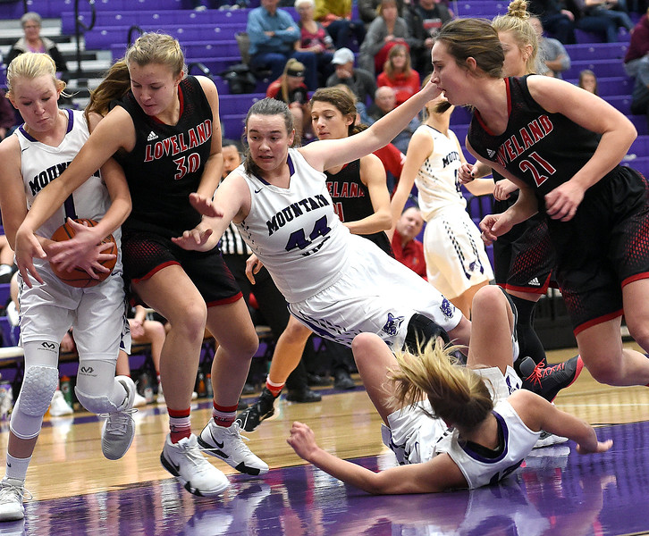 Mountain View's Harley Duke and Loveland's Kajsa Borrman scuffle over the ball during their game Wednesday, Nov. 28, 2018, at Mountain View High in Loveland. (Photo by Jenny Sparks/Loveland Reporter-Herald)