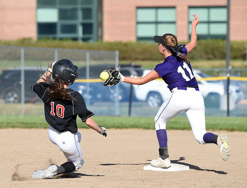 Loveland's (10) Jessi Case slides safely into second Mountain View's (11) Peyton Duke tries to catch the ball Wednesday, Sept. 20, 2017, during their game at Mountain View in Loveland. (Photo by Jenny Sparks/Loveland Reporter-Herald)