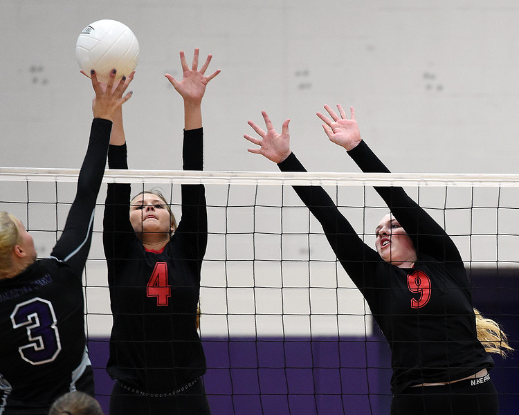 Loveland's (4) Olivia Emerson and (9) Alexa Rodgers try to block the ball as Mountain View's (3) Calli Wilson tips the ball over the net during their volleyball game Tuesday, Aug. 28, 2018, at Mountain View High in Loveland.  (Photo by Jenny Sparks/Loveland Reporter-Herald)