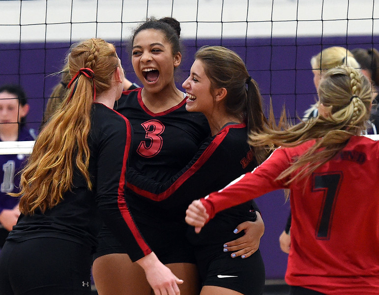 Loveland's (3) Calli Wilson and teammates celebrate a point sduring their volleyball game against Mountain View Tuesday, Aug. 28, 2018, at Mountain View High in Loveland.  (Photo by Jenny Sparks/Loveland Reporter-Herald)