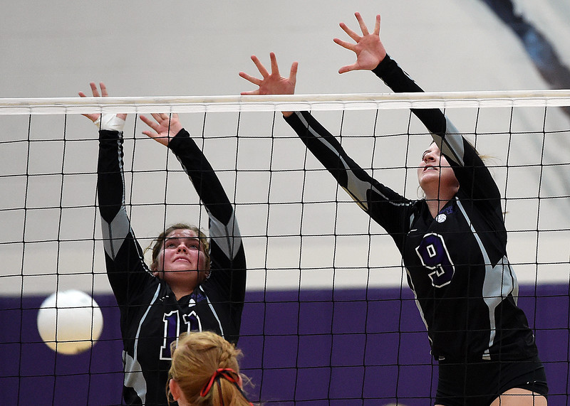 Mountain View's (11) Taylor Lenhart and (9) Madi Emsing try to block the ball during their volleyball game against Loveland Tuesday, Aug. 28, 2018, at Mountain View High in Loveland.  (Photo by Jenny Sparks/Loveland Reporter-Herald)