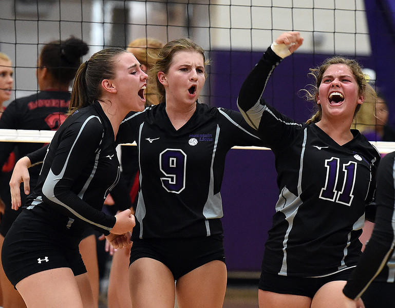 Mountain View's (9) Madi Emsing and teammates celebrate a point during their volleyball game against Loveland Tuesday, Aug. 28, 2018, at Mountain View High in Loveland.  (Photo by Jenny Sparks/Loveland Reporter-Herald)