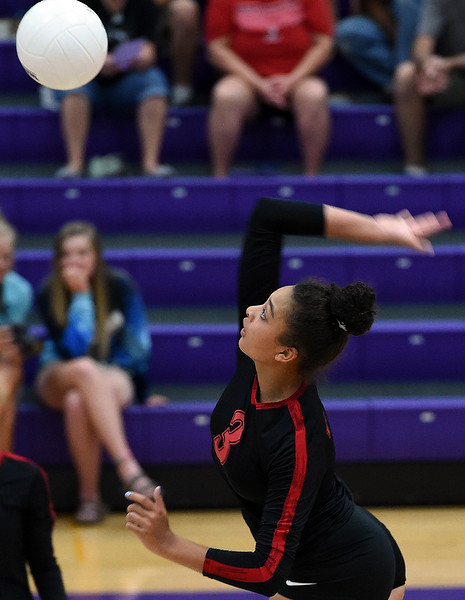 Loveland's (3) Lacy Hunt spikes the ball during their volleyball game against Mountain View Tuesday, Aug. 28, 2018, at Mountain View High in Loveland.  (Photo by Jenny Sparks/Loveland Reporter-Herald)