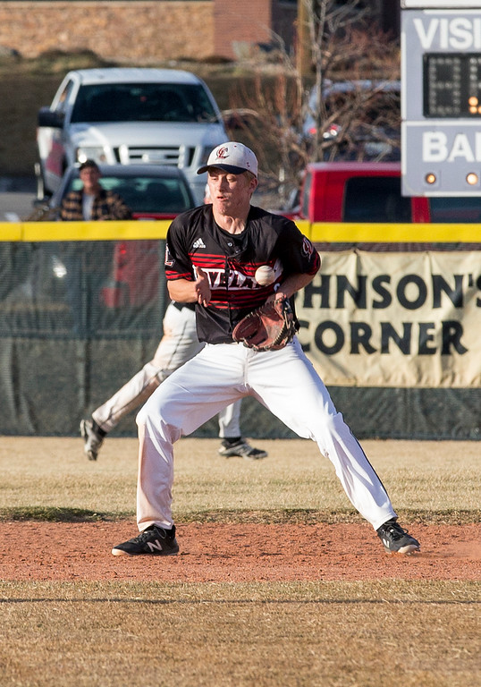 . Loveland\'s Tyler Hamill (9) can\'t get the handle on a ground ball against Mountain View Thursday afternoon Mar., 8, 2018 at Greg Brock Field in Loveland. The Mountain Lions beat the Indians, 11-2. (Michael Brian/For the Reporter-Herald)