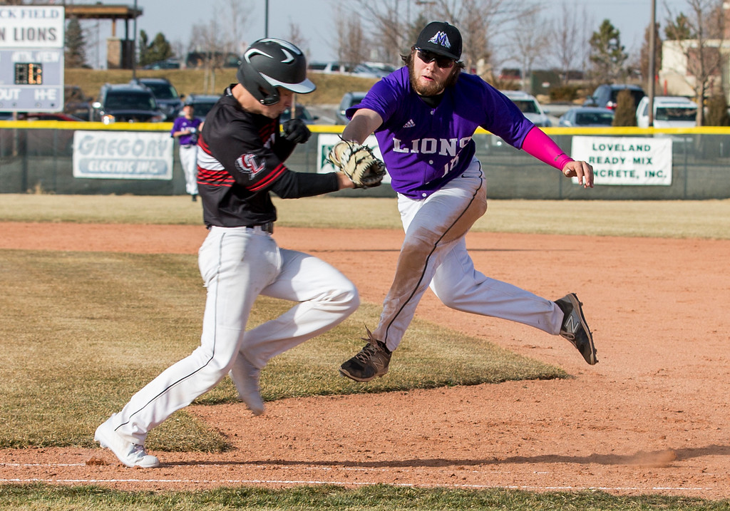 . Mountain View first baseman Dakota Jimenez (18) fields the ground ball and reaches to tag Loveland\'s A.J. Cortese (8) out Thursday afternoon Mar., 8, 2018 at Greg Brock Field in Loveland. The Mountain Lions beat the Indians 11-2. (Michael Brian/For the Reporter-Herald)