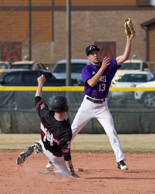 . Mountain View\'s T.J. Mendoza (13) forces out Loveland\'s Heron Lenze (14) at second base Thursday afternoon Mar., 8, 2018 at Greg Brock Field in Loveland. The Mountain Lions defeated the visiting Indians, 11-2. (Michael Brian/For the Reporter-Herald)
