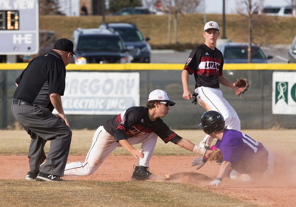 . Loveland\'s Jaxon Cabrera (1) gets the tag on Mountain View\'s Shane Shadowen (10) for an out at second base Thursday afternoon Mar., 8, 2018 at Greg Brock Field in Loveland. The Mountain Lions beat the Indians, 11-2. (Michael Brian/For the Reporter-Herald)